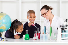 Science teacher and students Royalty Free Stock Images