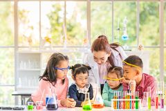 Science teacher teach students in laboratory room stock photo