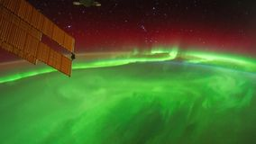 Science and Technology at aerospace. Beautiful and spectacular zoom in aerial view of time lapse Aurora Australis phenomenon from satellite at outer space stock illustration