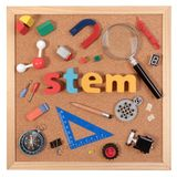 Science Technology Engineering Mathematics. STEM word on cork board with education equipment for background. STEM Education. Science Technology Engineering royalty free stock photography