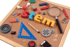 Science Technology Engineering Mathematics. STEM word on cork board with education equipment for background. STEM Education. Science Technology Engineering royalty free stock photo