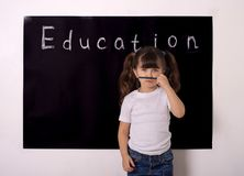 Science technology engineering maths STEM education concept. School girl kid. Studying kid. Pupil with glasses near black blackboard. Studio shoot, Cute kid back stock photography
