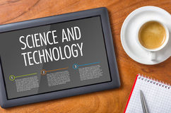 Science and Technology. Tablet on a wooden desk - Science and Technology