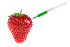 Science transgene food concept fruit syringe with Stock Image