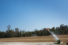 Science. Water bottle rocket blast off and water thrusting through the air Stock Photos