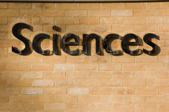 Sciences sign on a brick wall. Shiny metal sign on brick wall saying Sciences Royalty Free Stock Photos