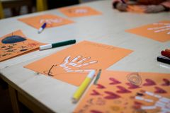 Scientific activity for children, drawing and collage of the bones of the hand. On a decorated orange sheet a hand was drawn and. Colored with felt-tip pens stock photos