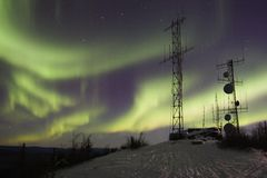 Scientific antennas and northern lights Stock Photography