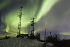 SCientific antennas under night sky with northern lights Royalty Free Stock Photos
