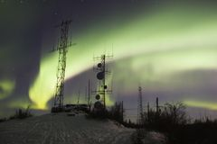 Scientific antennas under northern lights Royalty Free Stock Image