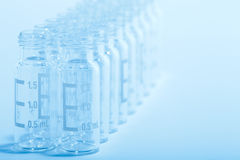 Scientific background - glass vials Royalty Free Stock Photos