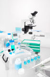 Scientific background with samples, pipette, and ice basket Stock Image