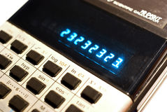 Scientific Calculator. Detail view of an old 10 digit scientific calculator with back lit display Stock Photos
