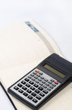 Scientific calculator on the business notebook Royalty Free Stock Photography