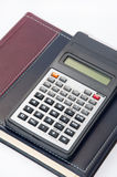 Scientific calculator on the business notebook Stock Images