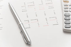 Scientific calculator and elegant silver pen Royalty Free Stock Images