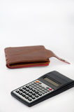 Scientific calculator and empty leather wallet Stock Image