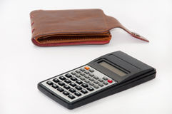 Scientific calculator and empty leather wallet Royalty Free Stock Images