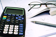 Scientific Calculator with exercise books. And glasses Stock Photo