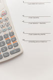 Scientific calculator on financial papers Royalty Free Stock Photo