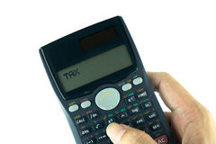 Scientific calculator in the hand isolated on white background Royalty Free Stock Image