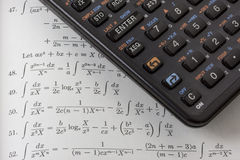 Scientific calculator on math textbook Royalty Free Stock Photos