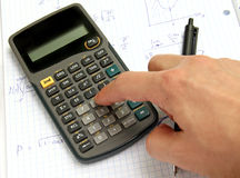 Scientific calculator on notebook paper Stock Images