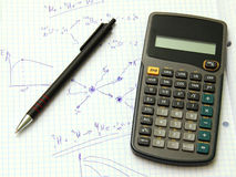 Scientific calculator and a pen Royalty Free Stock Photo