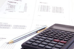 Scientific calculator and pen on the lecture note Stock Image