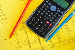 Scientific calculator and pen on yellow plan Royalty Free Stock Photography