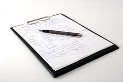 Scientific clipboard. With pen and paper covered with complicated formulas Stock Images