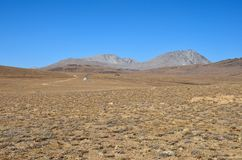 Scientific equipment by road in dry and barren Deosai Plains Gilgit-Baltistan Pakistan. Deosai Plains, Skardu, Pakistan - October 2, 2016: Dry and semi-rough royalty free stock images