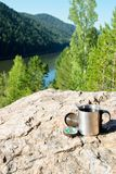 Scientific expedition. Along the river on the rocks stock photo