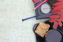 Scientific expedition. On the map. compass. cup, cookies royalty free stock image