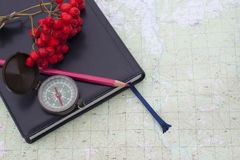 Scientific expedition. On the map. compass. knife royalty free stock photos