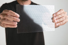 Scientific holding one piece transparent of graphene application with molecule formulate.  concept. Royalty Free Stock Photos