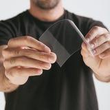 Scientific holding one piece transparent of graphene. Stock Photo
