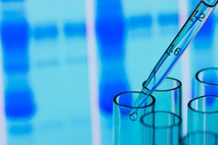 Scientific (or Medical) experiment. Drip tubes in front a scientific graph stock photography