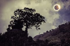 Scientific natural phenomenon. Total solar eclipse glowing on sk Royalty Free Stock Image
