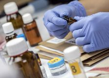 Scientific Police takes blood sample at Laboratorio forensic equipment royalty free stock photo