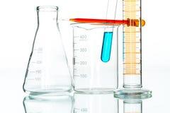 Scientific research glassware pipette drop, reflective white bac Stock Photo