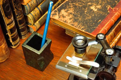 Scientific research. Microscope and books Stock Photos