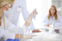 Scientific research team with clear solution in laboratory Stock Image