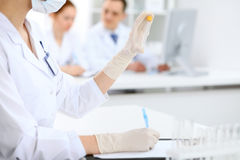Scientific research team with clear solution in laboratory Royalty Free Stock Images