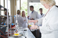 Scientific researcher doing a chemical experiment research.Science students working with chemicals. Chemist doing research with la stock photo