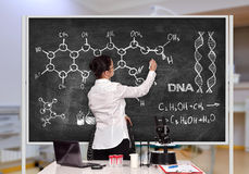 Scientific researcher drawing  chemical scheme Royalty Free Stock Images