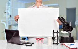 Scientific researcher holding blank placard Stock Photos
