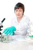 Scientific researcher in a lab. On a white background Royalty Free Stock Photos