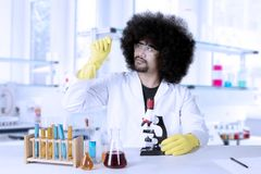 Scientific researcher looking at microscope slide Royalty Free Stock Images