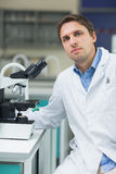 Scientific researcher with microscope in the laboratory Stock Photo